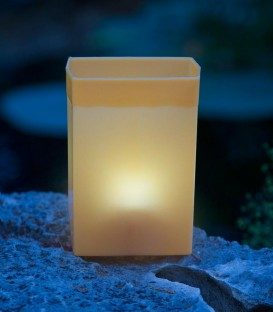 Individual Brown Luminary lit with candle